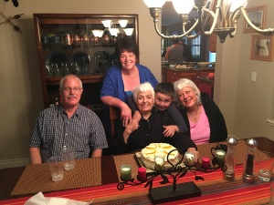 Mom, my siblings, my great nephew, and me at Mom's 93rd birthday